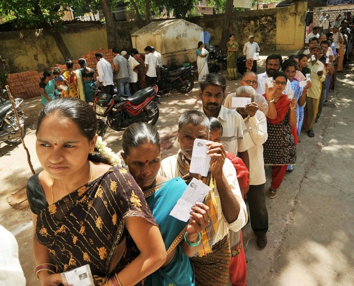 Voters standing in a queue to cast their votes, at a polling booth, during the 8th Phase of General Elections-2014,  at Madhavadhara,  in Visakhapatnam, Andhra Pradesh on May 07, 2014.