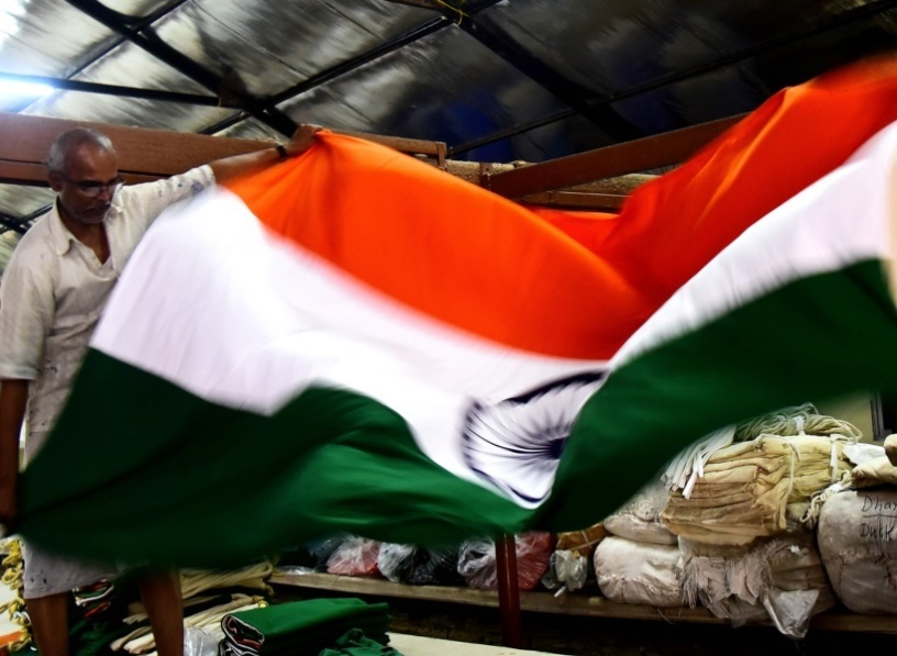 Workers pack and despatch  a huge flag in the workshop of Khadi Dyers and Printers at Korakendra, Borivili . Express Photo by Kevin DSouza 08-08-16,Mumbai