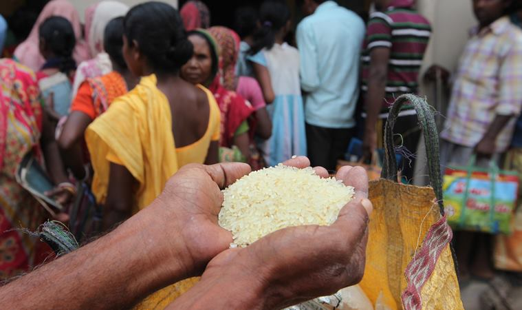 Villagers of Belatikri under Lalgargh PS queue at a ration shop for rice @ rupees 2 per kg on Sunday. Express photo by Partha Paul.Jhargram.27.03.16